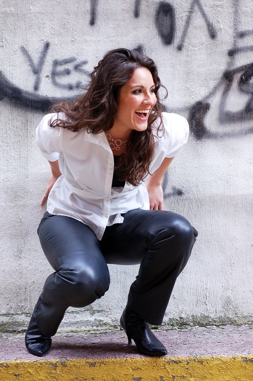 Emily in leather pants with concrete background